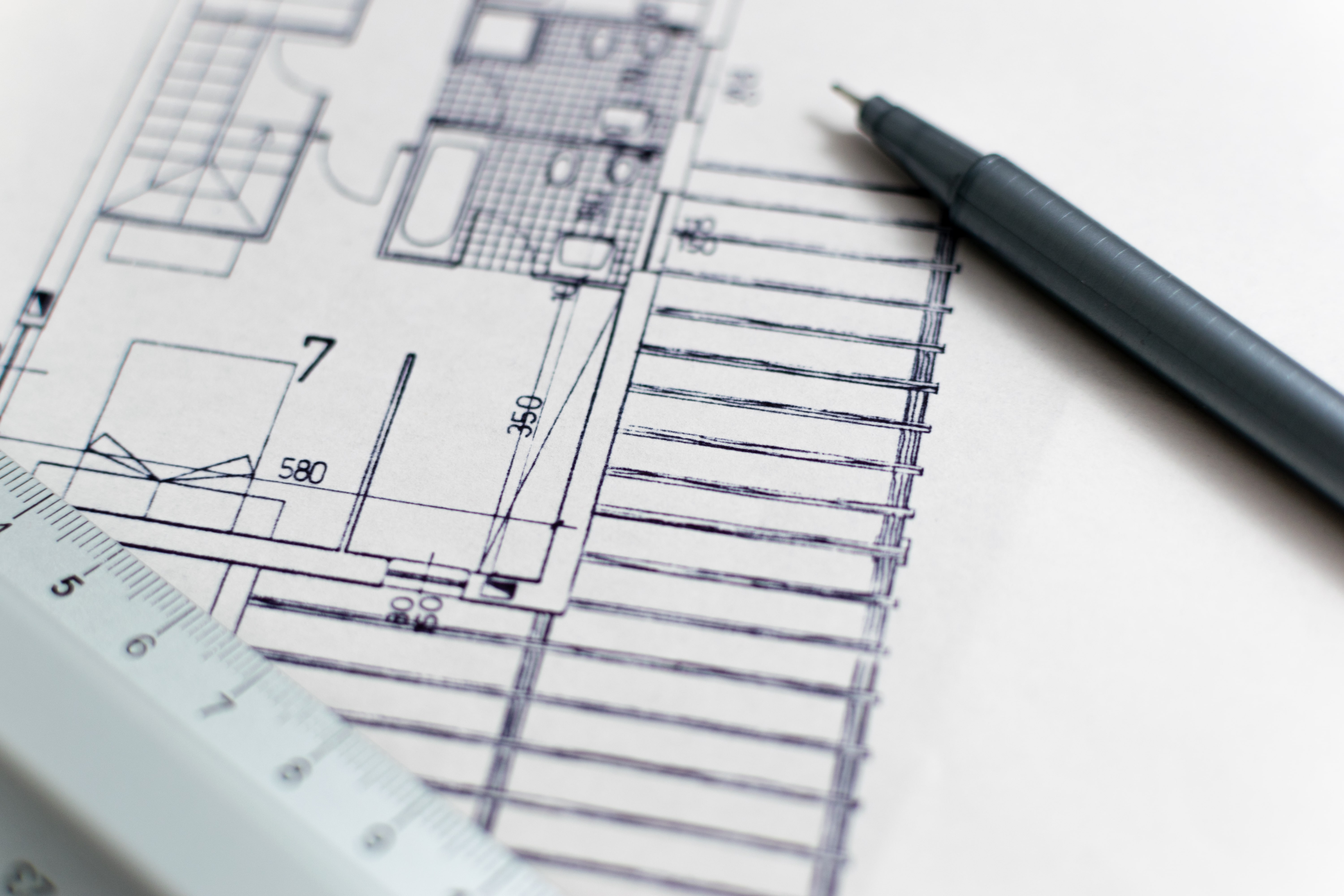 re blueprint with pen and ruler