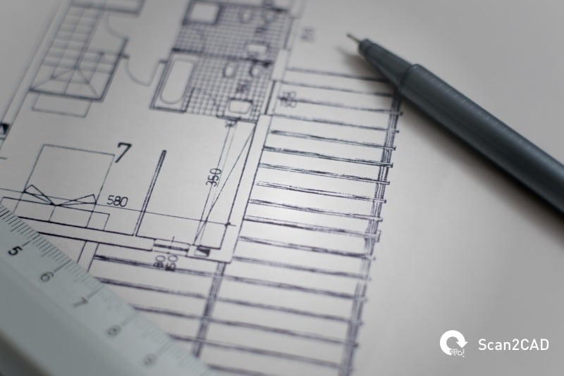 Pen and ruler on architectural drawing